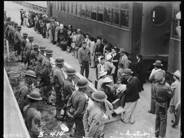 Photograph of Japanese Americans in line at the train